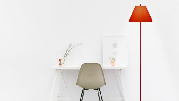 In a White room with Red floor lamp